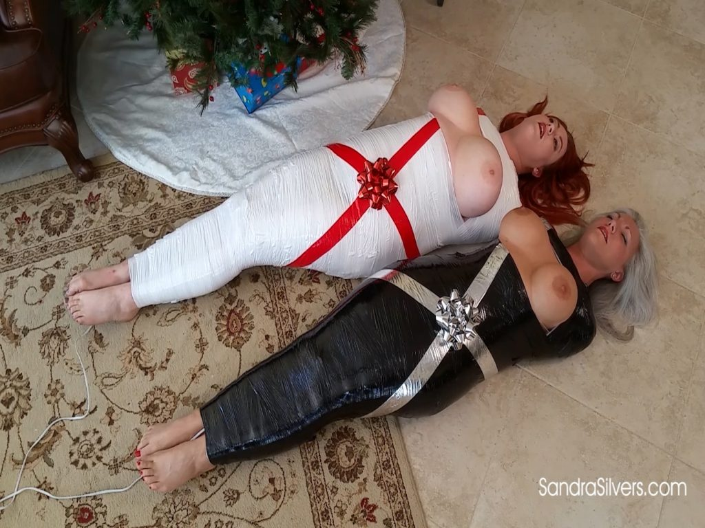 A pair of Mummified, Buxom Broads Left Under Your Christmas Tree, Ready for Dual Bound Orgasms! HD 1671