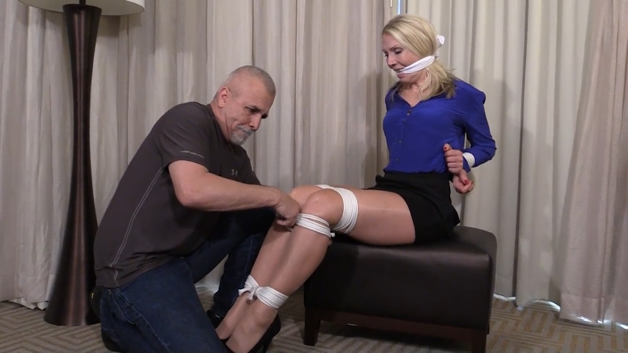 Busty blond tourist kept tied up in her pantyhose