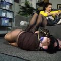 Bratty office worker left hogtied with a stocking over her pretty young face