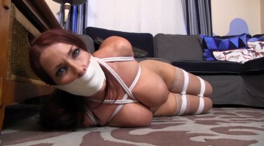 Big busted English Tart tied up naked with her panties taped in her mouth