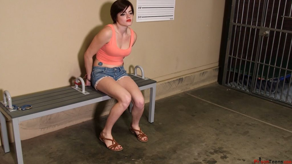 Violet Pixie is brought in, processed, and placed in a cell. – Prison Teens
