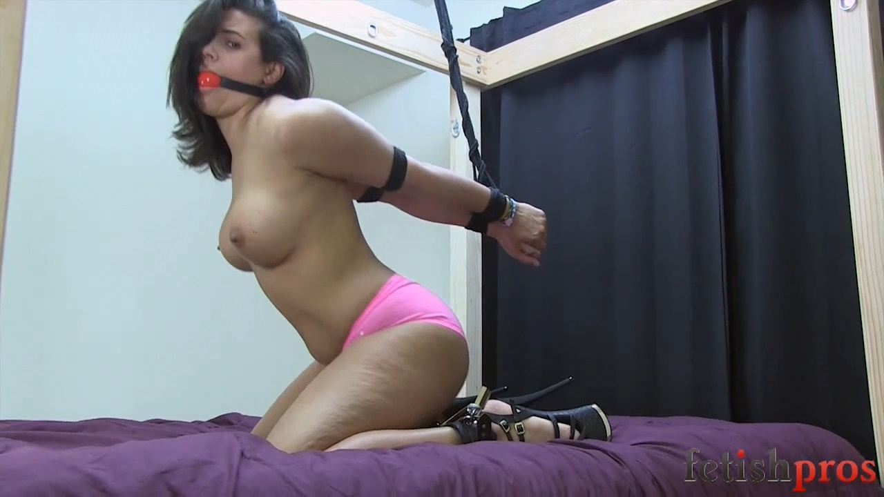 Penny Barber Bound in Rope Gagged struggling on Bed