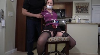 Sitting here tied up with a sock stuffed mouth and a tight over the mouth gag – Girl Next Door Bondage