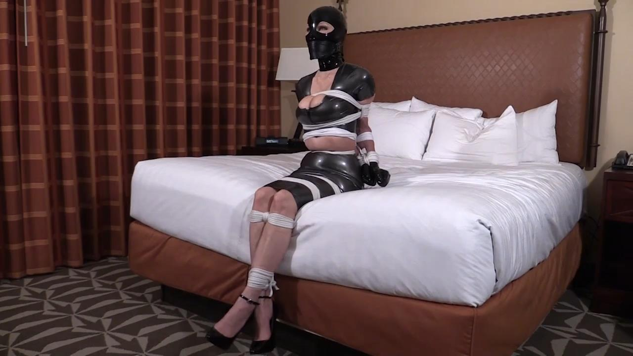 Bound gagged and hooded in Latex