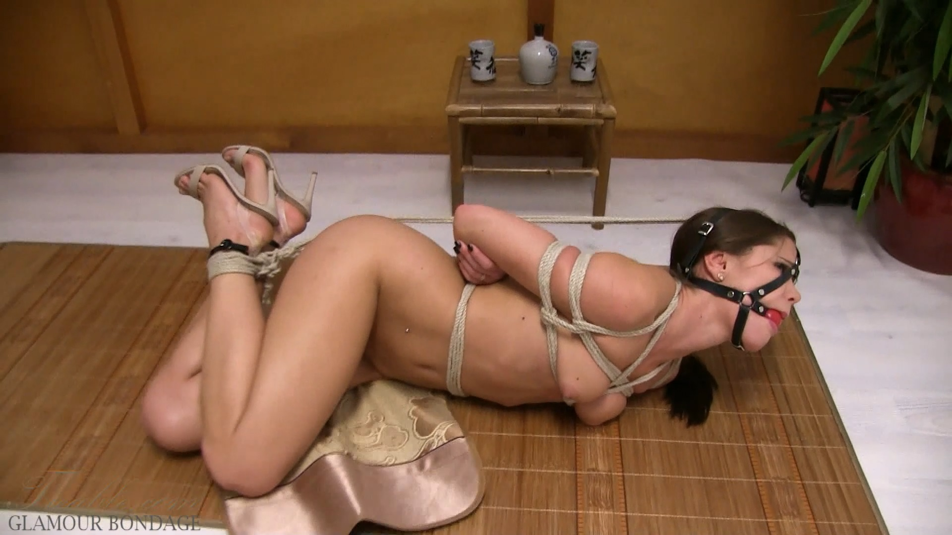 Little Caprice harness gag hogtie