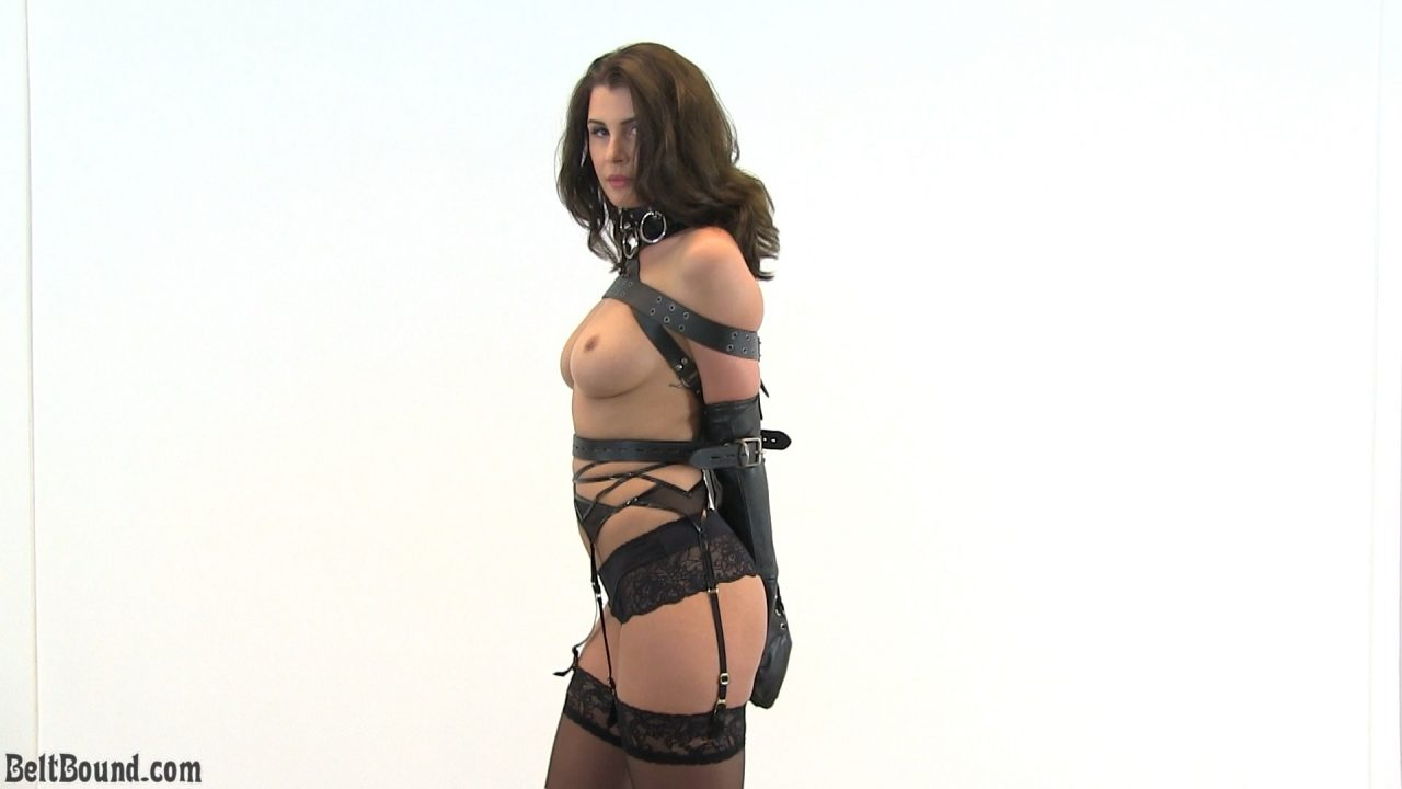 Alisa_glamour model strapped in an armbinder