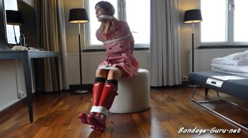 LILLY RAINBOUND AND CLEAVEGAGGED – RUBBER AND RAINWEAR BONDAGE