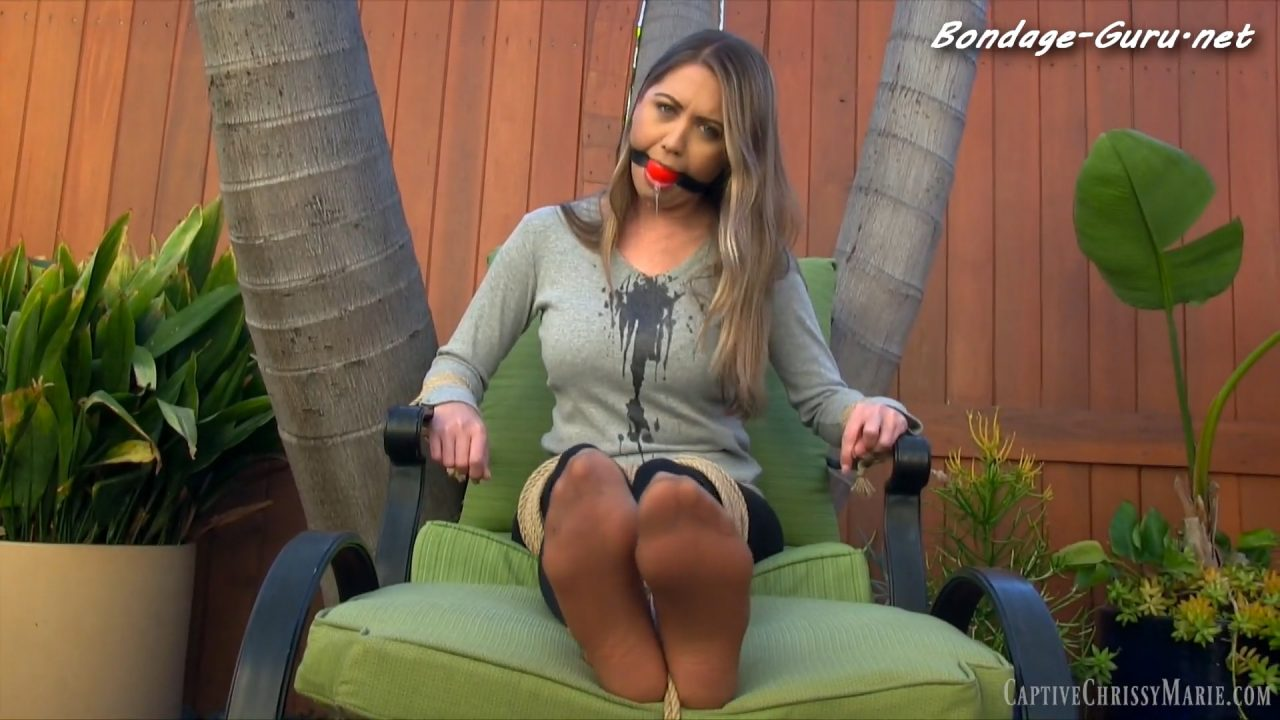Helplessly Ballgagged & Drooling In The Backyard