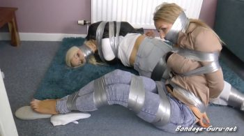 Penny & Fiona in: Taped Up Ridiculously Tightly, With Their Own Socks Gagging Them DOUBLE, If They Could Juuust Get To That Phone… (Full Clip) – Borderland Bound
