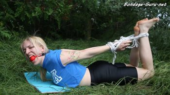 Shiny leather heaven – Bound and gagged woman is trying to escape outdoors