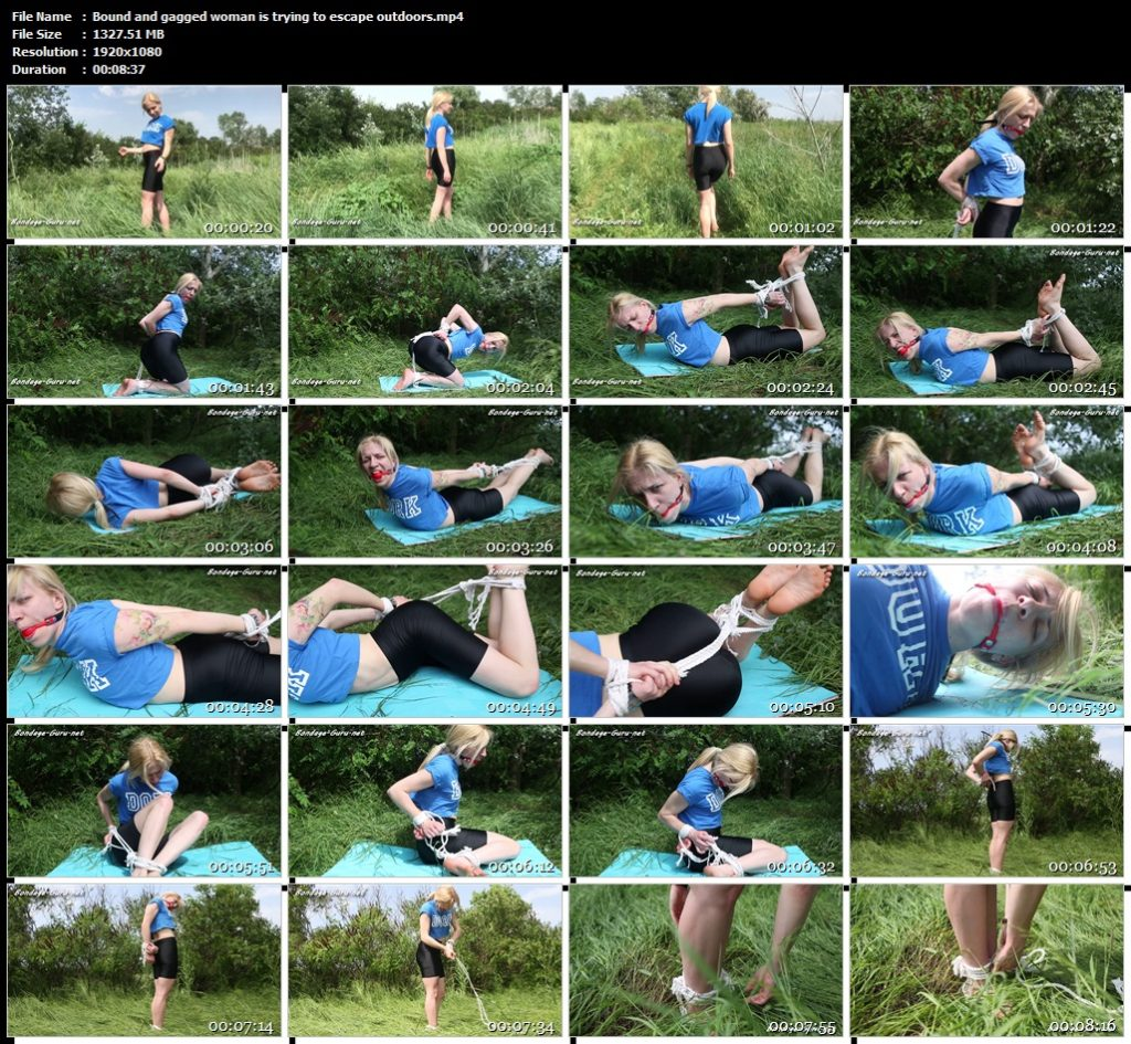 Bound and gagged woman is trying to escape outdoors.mp4