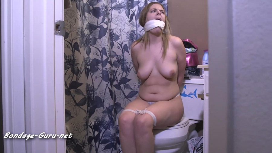 Hopping away bound and gagged in just her panties