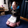 PVC Maid Gets Tied in Rope Bondage and Forced to Wear Panties on Her Head with a Nose Hook
