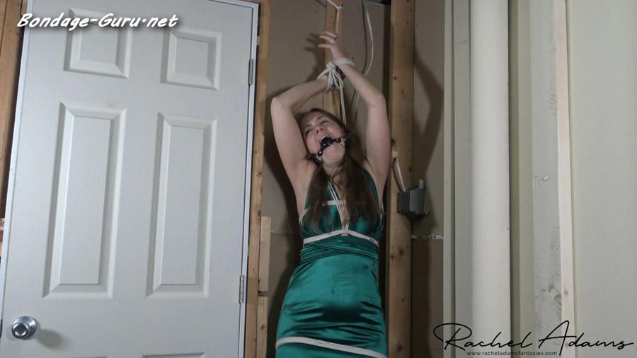 Rachel Adams bound in a green gown hands overhead