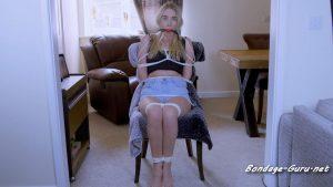 Arabella bound to a chair