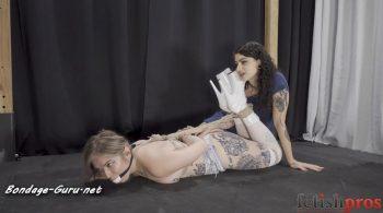 Fetish Pros Bondage Fetish Videos – Hogtied Topless Kaiia Eve is Lydia Black's Vulnerable Plaything